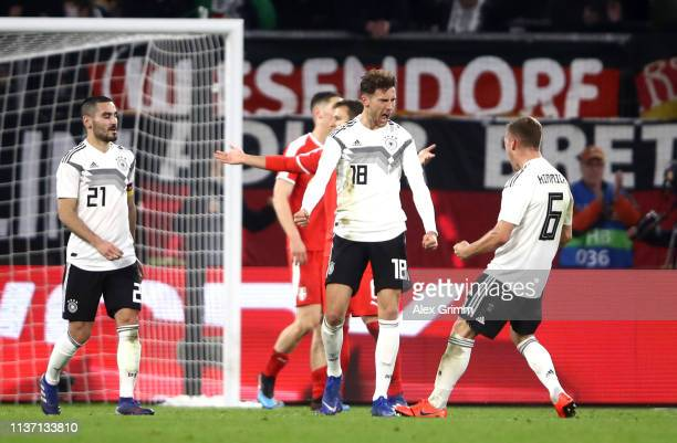 Leon Goretzka of Germany celebrates with team mate Joshua Kimmich of Germany after scoring their team's first goal during the International Friendly...