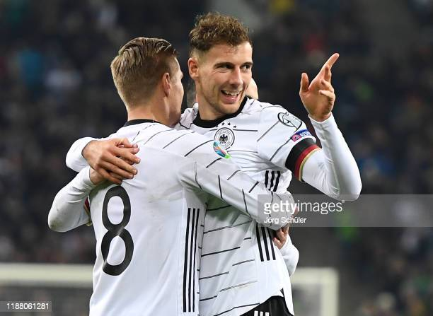 Leon Goretzka of Germany celebrates with team mate Toni Kroos after scoring his team's second goal during the UEFA Euro 2020 Group C Qualifier match...