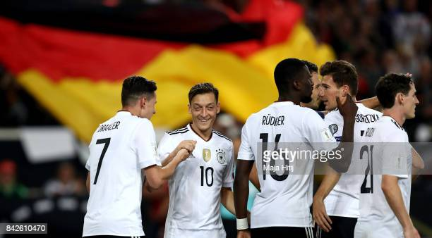 Leon Goretzka of Germany celebrates with team mates after scoring his teams fifth goal during the FIFA 2018 World Cup Qualifier between Germany and...