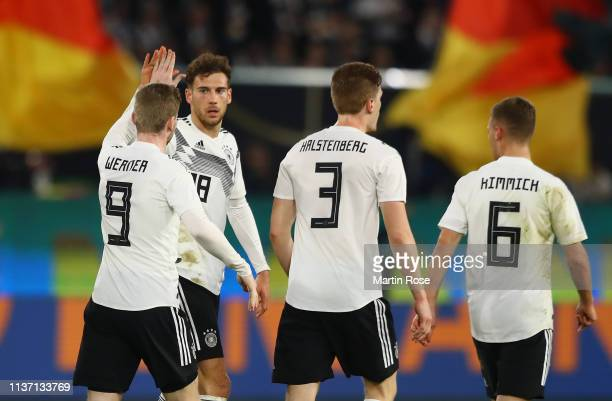 Leon Goretzka of Germany celebrates with team mates after scoring their team's first goal during the International Friendly match between Germany and...