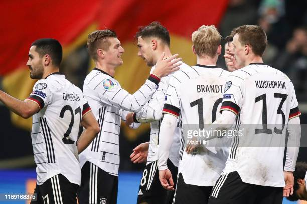 Leon Goretzka of Germany celebrates with teammate safter scoring his team's second goal during the UEFA Euro 2020 Qualifier between Germany and...