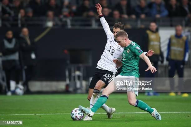 Leon Goretzka of Germany challenges Shane Ferguson of Northern Ireland during the UEFA Euro 2020 Qualifier between Germany and Northern Ireland at...
