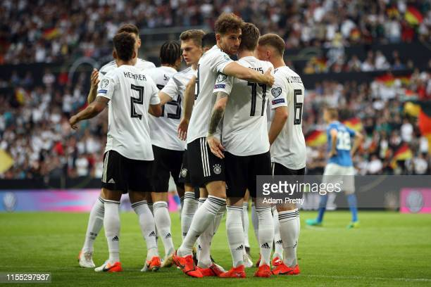 Leon Goretzka of Germany hugs Marco Reus of Germany after scoring during the UEFA Euro 2020 Qualifier match between Germany and Estonia at Opel Arena...