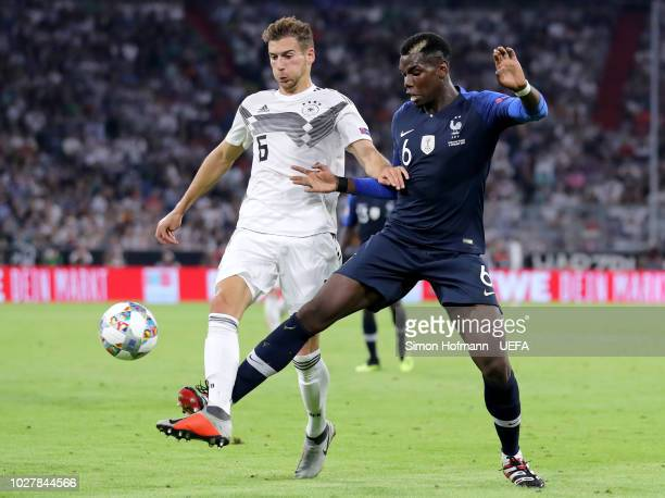 Leon Goretzka of Germany is challenged by Paul Pogba of France during the UEFA Nations League Group A match between Germany and France at Allianz...