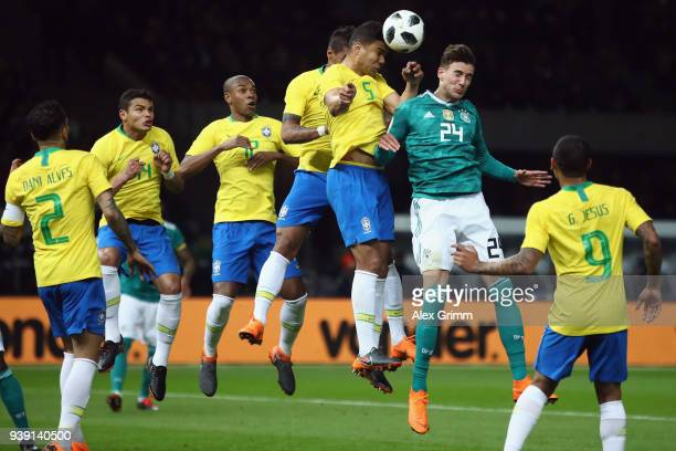 Leon Goretzka of Germany jumps for a header with Casemiro of Brazil during the international friendly match between Germany and Brazil at...