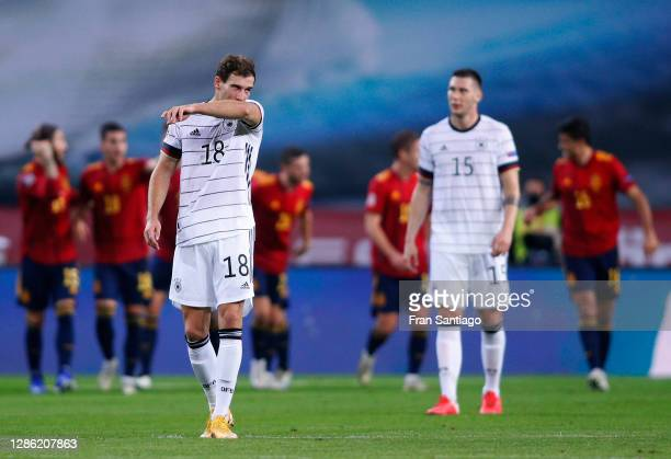 Leon Goretzka of Germany reacts as Rodri of Spain celebrates his team's third goal with teammates during the UEFA Nations League group stage match...