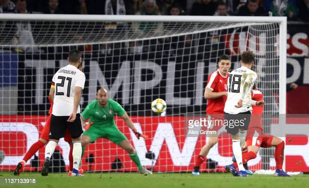 Leon Goretzka of Germany scores his team's first goal past Marko Dmitrovic of Serbia during the International Friendly match between Germany and...