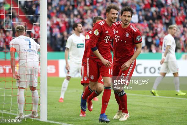 Leon Goretzka of Muenchen celebrates his team's first goal with team mate Mats Hummels during the DFB Cup quarterfinal match between Bayern Muenchen...