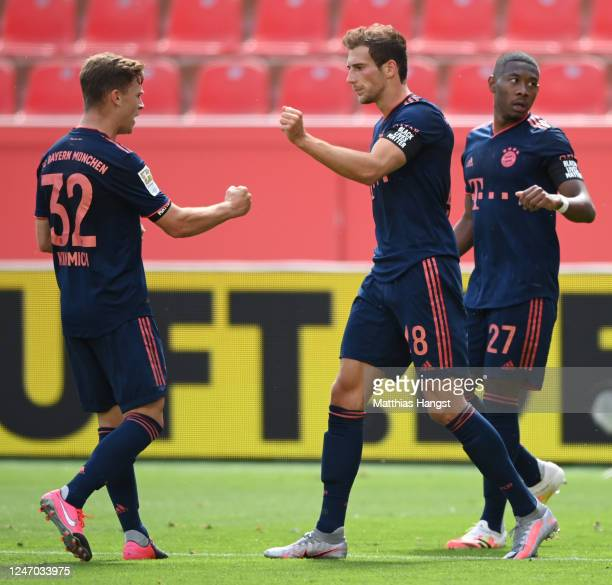 Leon Goretzka of Muenchen celebrates his team's second goal with team mates Joshua Kimmich and David Alaba during the Bundesliga match between Bayer...