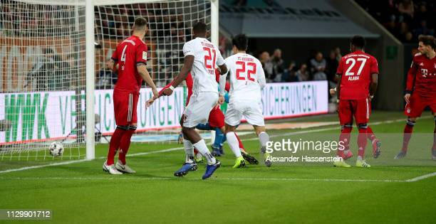 Leon Goretzka of Muenchen scores an own goal during the Bundesliga match between FC Augsburg and FC Bayern Muenchen at WWKArena on February 15 2019...