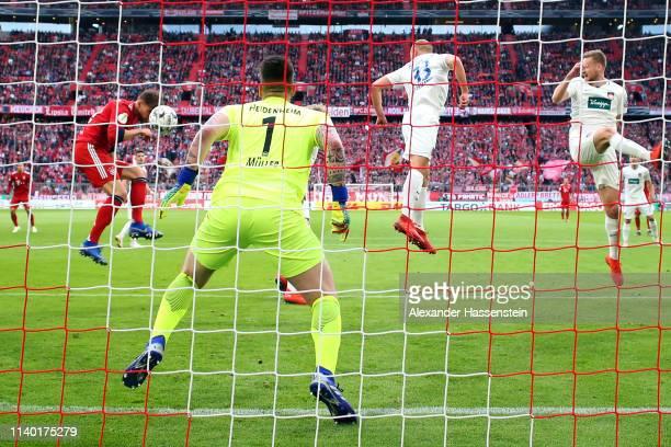 Leon Goretzka of Muenchen scores his team's first goal past goalkeeper Kevin Mueller of Heidenheim during the DFB Cup quarterfinal match between...