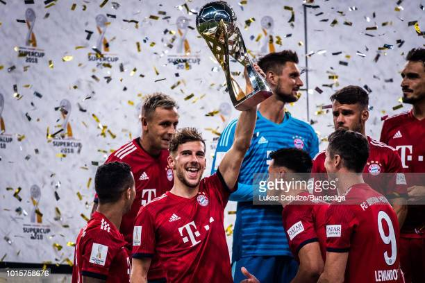 Leon Goretzka of Munich lifts the trophy after winning the DFL Supercup 2017 match between Eintracht Frankfurt and Bayern Muenchen at...