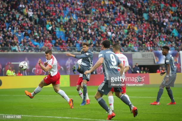 Leon Goretzka of Nayern Muenchen scores a off side goal next to his team mate Robert Lewandowski during the Bundesliga match between RB Leipzig and...