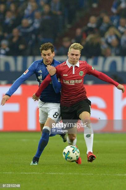 Leon Goretzka of Schalke and Felix Klaus of Hannover battle for the ball during the Bundesliga match between FC Schalke 04 and Hannover 96 at...