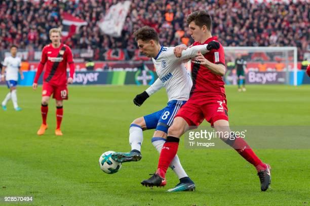 Leon Goretzka of Schalke and Panagiotis Retsos of Leverkusen battle for the ball during the Bundesliga match between Bayer 04 Leverkusen and FC...