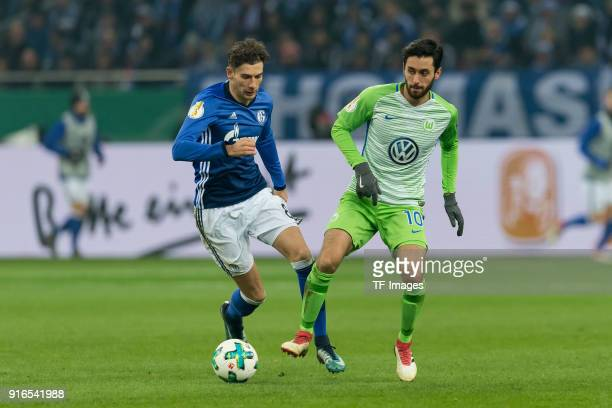 Leon Goretzka of Schalke and Yunus Malli of Wolfsburg battle for the ball during the DFB Cup match between FC Schalke 04 and VfL Wolfsburg at...