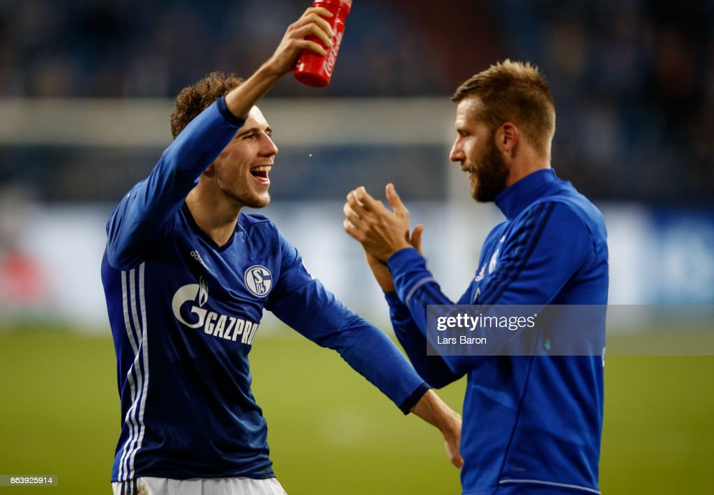 Leon Goretzka of Schalke celebrates with Guido Burgstaller of Schalke after winning the Bundesliga match between FC Schalke 04 and 1. FSV Mainz 05 at Veltins-Arena on October 20, 2017 in Gelsenkirchen, Germany.
