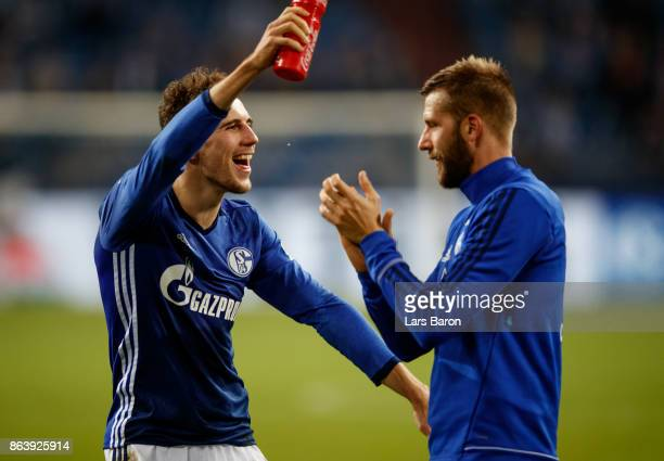 Leon Goretzka of Schalke celebrates with Guido Burgstaller of Schalke after winning the Bundesliga match between FC Schalke 04 and 1 FSV Mainz 05 at...