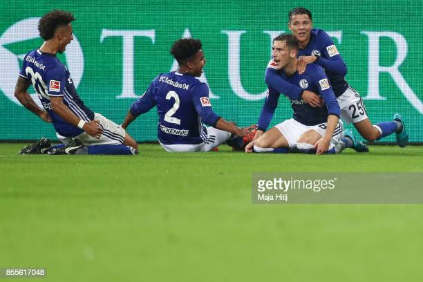 Leon Goretzka of Schalke celebrates with his teammates after scoring his team's first goal to make it 10 during the Bundesliga match between FC...