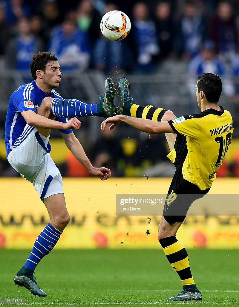 Leon Goretzka of Schalke challenges Henrikh Mkhitaryan of Dortmund during the Bundesliga match between Borussia Dortmund and FC Schalke 04 at Signal Iduna Park on November 8, 2015 in Dortmund, Germany.