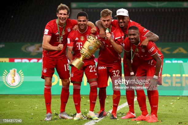 Leon Goretzka Serge Gnabry Joshua Kimmich Jerome Boateng and David Alaba of FC Bayern Muenchen pose with the trophy in celebration after the DFB Cup...