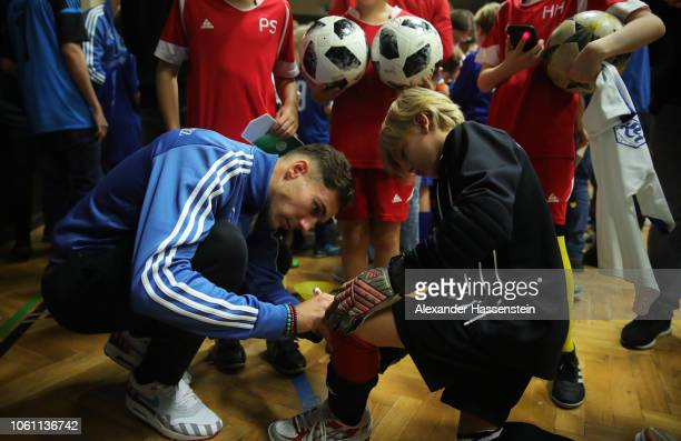 Leon Goretzka signs autographs during a visit by Germany players to Club SV Lindenau at Helmholtzschule on November 13 2018 in Leipzig Germany