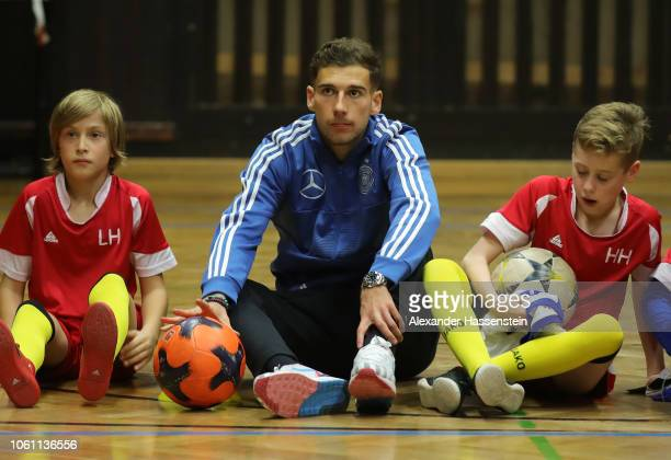 Leon Goretzka sits alongside young footballers during a visit by Germany players to Club SV Lindenau at Helmholtzschule on November 13 2018 in...