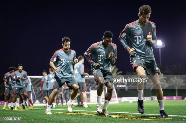 Leon Goretzka warms up infront of David Alaba and Mats Hummels during a training session at day four of the Bayern Muenchen training camp at Aspire...