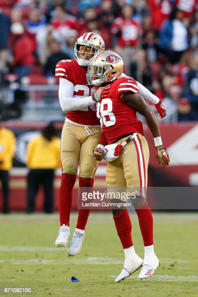 Leon Hall and Adrian Colbert of the San Francisco 49ers celebrate after w turnover against the Arizona Cardinals at Levi's Stadium on November 5 2017...