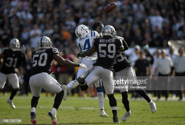 Leon Hall and Tahir Whitehead of the Oakland Raiders breaks up the pass to Zach Pascal of the Indianapolis Coltss during the second half of their NFL...