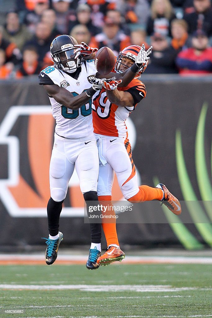 Leon Hall #29 of the Cincinnati Bengals attempts to break up a pass for Allen Hurns #88 of the Jacksonville Jaguars during the fourth quarter at Paul Brown Stadium on November 2, 2014 in Cincinnati, Ohio. Cincinnati defeated Jacksonville 33-23.