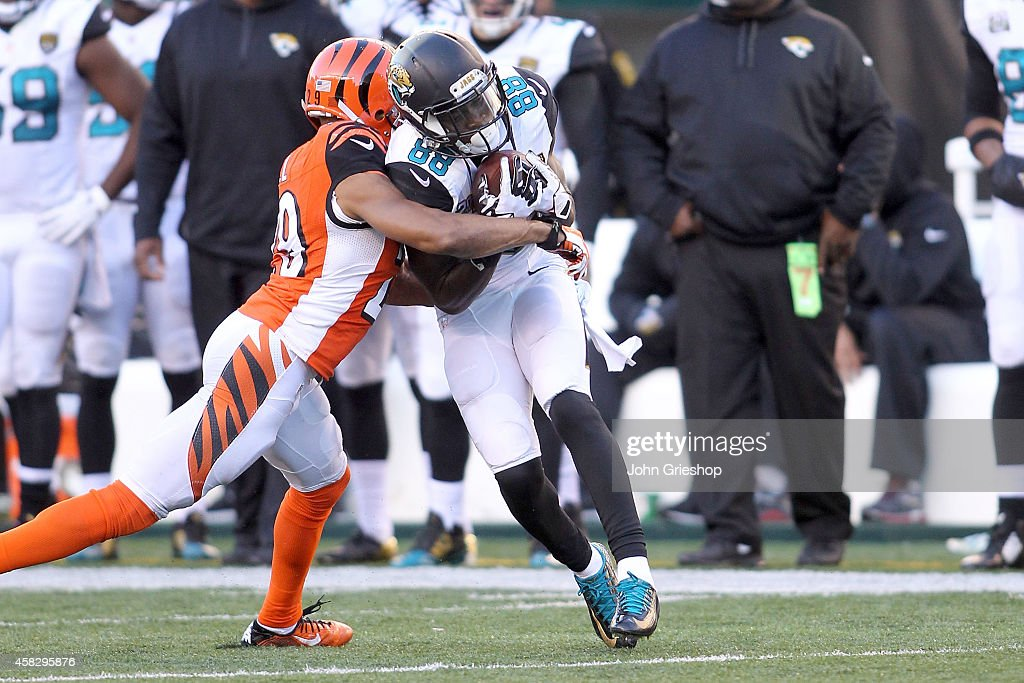 Leon Hall #29 of the Cincinnati Bengals tackles Allen Hurns #88 of the Jacksonville Jaguars during the fourth quarter at Paul Brown Stadium on November 2, 2014 in Cincinnati, Ohio. Cincinnati defeated Jacksonville 33-23.