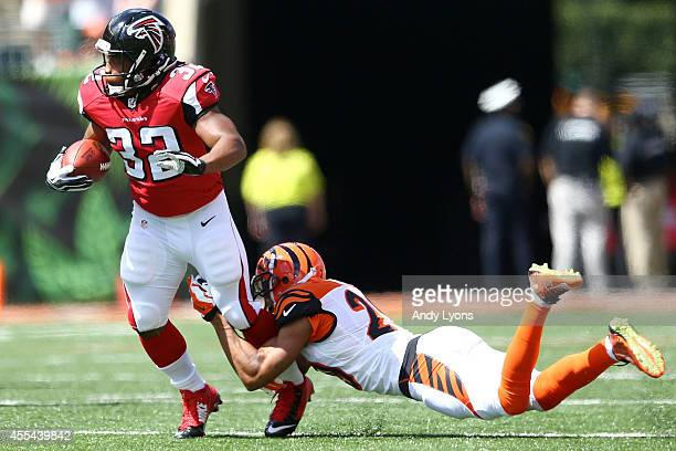 Leon Hall of the Cincinnati Bengals tackles Jacquizz Rodgers of the Atlanta Falcons during the first quarter at Paul Brown Stadium on September 14...