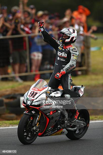 Leon Haslam of Great Britain and rider of the Aprilia Racing Team Red Devils Aprilia RSV4 RF celebrates after winning race two of the World...