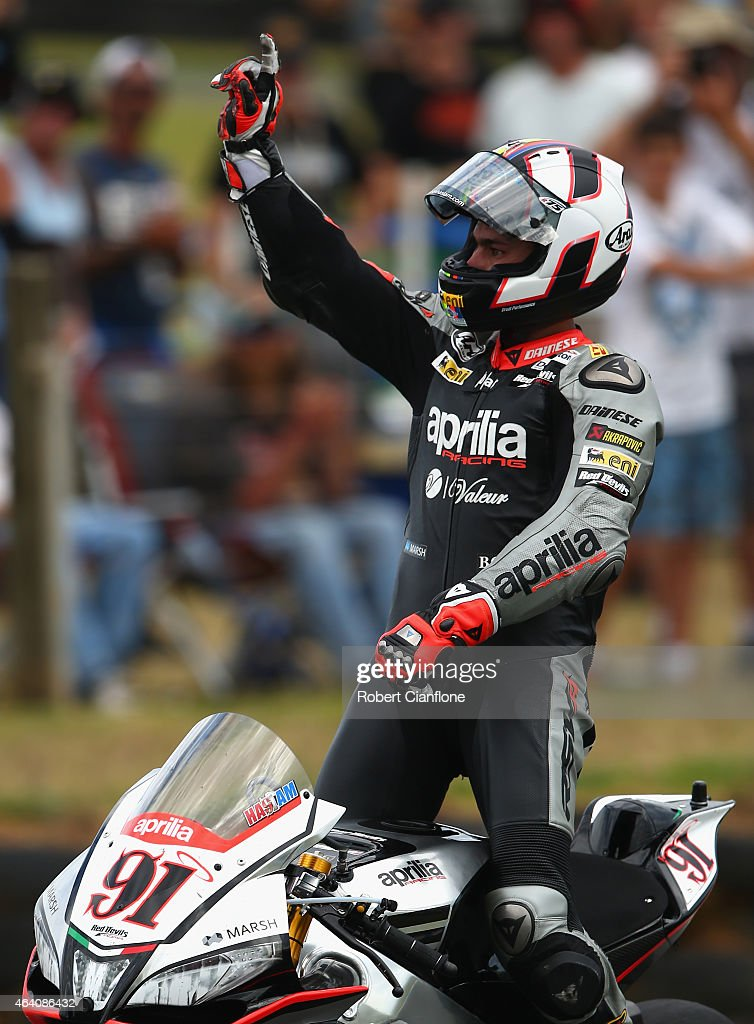 Leon Haslam of Great Britain and rider of the #91 Aprilia Racing Team Red Devils Aprilia RSV4 RF celebrates after winning race two of the World Superbikes World Championship Australian Round at Phillip Island Grand Prix Circuit on February 22, 2015 in Phillip Island, Australia.