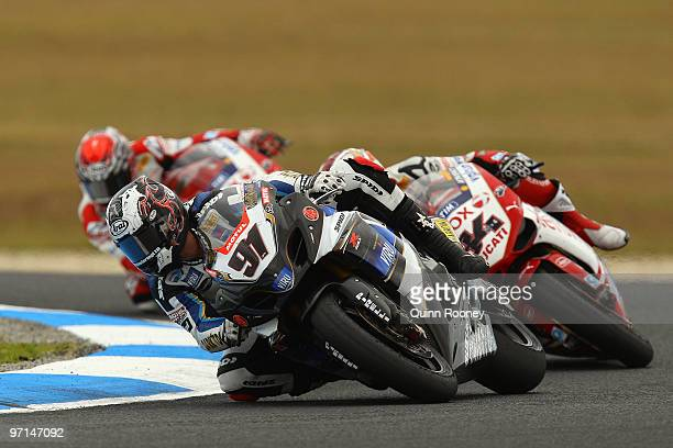 Leon Haslam of Great Britain and Team Suzuki Alstare leads the field during the Superbike World Championship round one race one at Phillip Island...