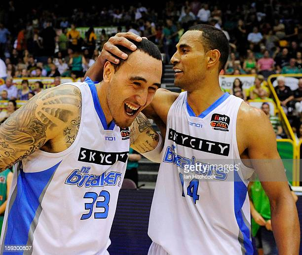 Leon Henry and Mika Vukona of the Breakers celebrate after winning the round 14 NBL match between the Townsville Crocodiles and the New Zealand...