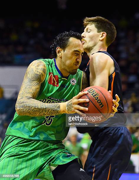 Leon Henry of the Crocodiles drives to the basket during the round nine NBL match between the Townsville Crocodiles and the Cairns Taipans on...