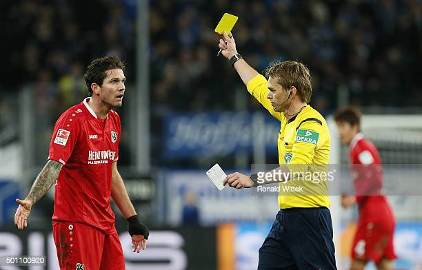 Leon Hougaard Andreasen of Hannover is shown the yellow card by Referee Jochen Drees during the Bundesliga match between 1899 Hoffenheim and Hannover...