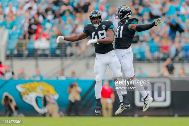 Leon Jacobs of the Jacksonville Jaguars and Josh Allen celebrate after forcing a punt during the first quarter of a game against the Tampa Bay...