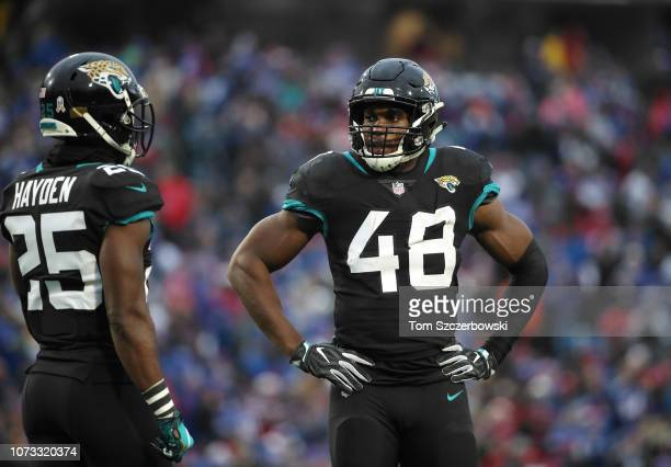 Leon Jacobs of the Jacksonville Jaguars talks to D.J. Hayden during a break in the action during NFL game action against the Buffalo Bills at New Era...