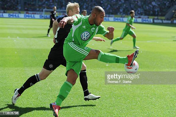 Leon Jessen of Kaiserslautern challenges Ashkan Dejagah of Wolfsburg during the Bundesliga match between VfL Wolfsburg and 1 FC Kaiserslautern at...
