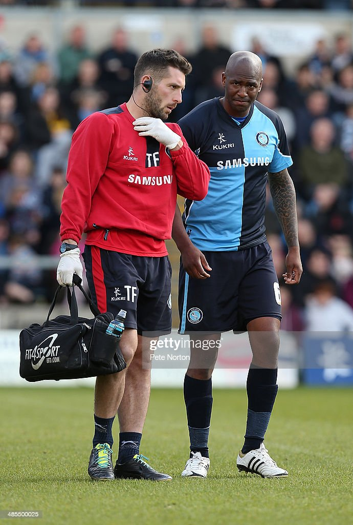Leon Johnson of Wycombe Wanderers leaves the pitch with physio Theo Farley after sustaining an injury during the Sky Bet League Two match between Wycombe Wanderers and Northampton Town at Adams Park on April 18, 2014 in High Wycombe, England.