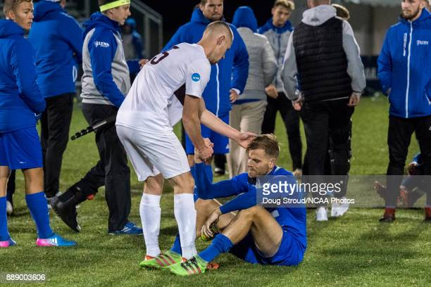 Leon Kroiss of the University of Charleston consoles Lukas Börner of Lynn University after the Division II Men's Soccer Championship held at the...