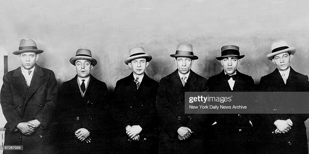 Leon Liss, Barney Mortillaro, Milton (Shuffles) Goldberg, Louis Liss, Pasquale Chicarelli and gang leader Richard Reese Whittemore (l. to r.) in a police lineup, after they were implicated in a gem holdup on W. 48th St.