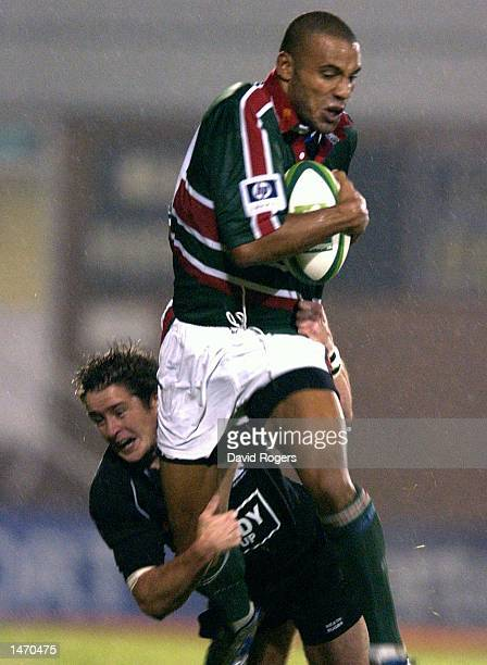 Leon Lloyd of Leicester is tackled by Shane Williams of Neath during the Heineken Cup match between Neath and Leicester Tigers at The Gnoll Neath...