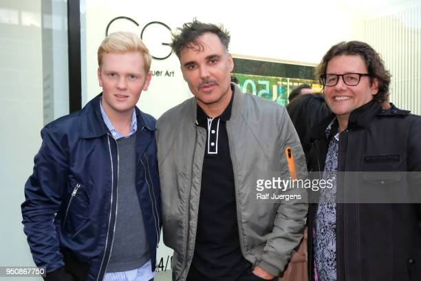 Leon Loewentraut David LaChappelle and galerist Dirk Geuer attend the 'LACHAPELLE Negative Currency' Exhibition Opening at Geuer und Geuer on April...