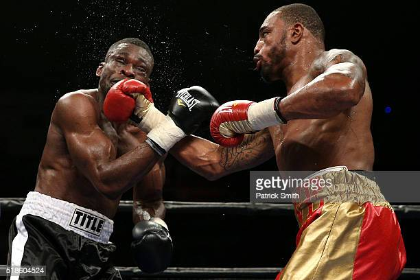 Leon Love and Michael Gbenga exchange punches in their super middleweights bout at the DC Armory on April 1, 2016 in Washington, DC.