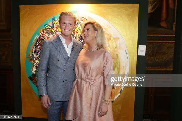 """Leon Löwentraut and Heike Löwentraut attend the exhibition opening """"Leonismo"""" by artist Leon Loewentraut on May 21, 2021 in Venice, Italy. In the..."""