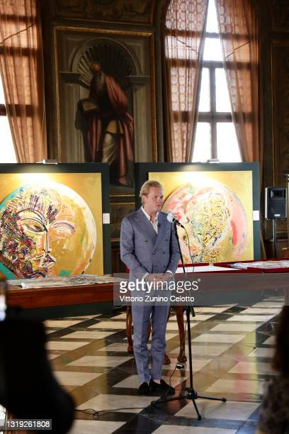 """Leon Löwentraut attends the exhibition opening """"Leonismo"""" by artist Leon Loewentraut on May 21, 2021 in Venice, Italy. In the library, directly on..."""